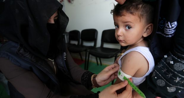 A paediatrician measures a child at a mobile clinic in north Azaz, Syria. Photograph: Khalil Ashaw/Reuters