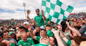 Limerick's Diarmaid Byrnes celebrates with fans after they won the Munster SHC semi-final against Tipperary. Photo: James Crombie/Inpho