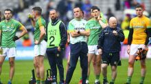 Meath manager Andy McEntee stands dejected with his players following the Leinster final defeat to Dublin at Croke Park. Photograph: Ken Sutton/Inpho