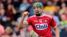 Cork's Aidan Walsh celebrates a goal against Clare. He has worn the senior county jersey with distinction in both football and hurling.   Photograph: Laszlo Geczo/Inpho