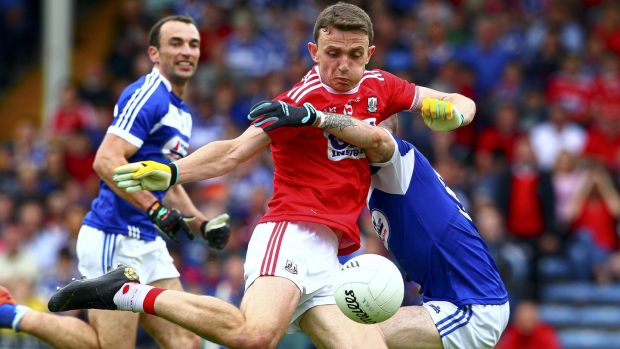Mark Collins scores his goal in Cork's rout of Laois. Photograph: Ken Sutton/Inpho