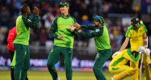 Andile Phehlukwayo and Dwaine Pretorius of South Africa celebrate the last wicket and their win at Old Trafford. Photograph: Getty Images