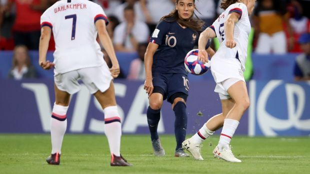 Kelley O'Hara appears to handle Amel Majri's cross during the USA's win over hosts France. Photograph: Alex Grimm/Getty