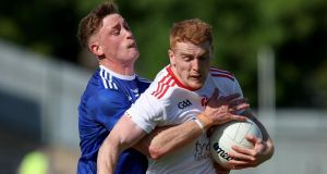 Cavan's Ciaran Brady tackles Peter Harte of Tyrone during their All-Ireland SFC round 4 qualifier at St Tiernach's Park, Clones, Co Monaghan on Saturday. Photograph: Bryan Keane/Inpho