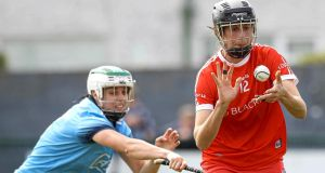 Cork's Orla Cotter and Grainne Quinn of Dublin in action during their Camogie Championship Round 4 clash. Photograph: Lorraine O'Sullivan/Inpho