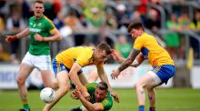 Meath's Michael Newman is challenged by Cillian Brennan of Clare during their tightly fought contest in Portlaoise. Photograph: Ryan Byrne/Inpho