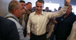 New Democracy conservative party leader Kyriakos Mitsotakis is greeted by supporters as he arrives at the party's headquarters in Athens, Greece on Sunday. Photograph: Costas Baltas/Reuters
