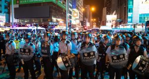 Police arrested six people during a demonstration in one of Hong Kong's most popular tourist areas on Sunday Photographer: Kyle Lam/Bloomberg