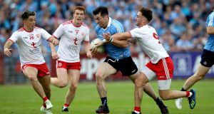 Tyrone's Padraig Hampsey and Michael Darragh Macauley of Dublin in last year's Championship quarter-final, phase 2, at Healy Park, Omagh. Photograph: Ryan Byrne/Inpho