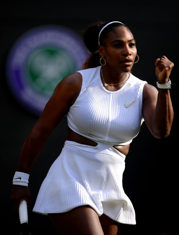 Serena Williams bends the dress-code rules at Wimbledon, in her whites with cutouts and decorative Nike 'broosh'. Photograph: Laurence Griffiths/Getty Images
