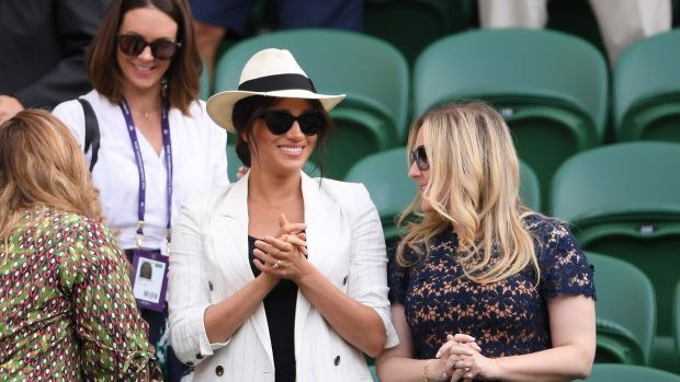 Meghan Markle, Duchess of Sussex went for a more casual look, with oversized sunglasses and an A necklace for her son Archie. Photograph: Laurence Griffiths/Getty Images