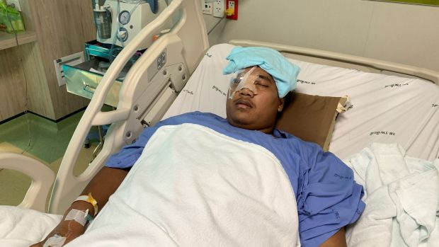 Sirawith Seritiwat, a Thai pro-democracy activist, in hospital in Bangkok after he was attacked. Photograph: Reuters