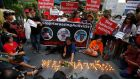 "Thai pro-democracy demonstrators place flowers and candles to create the Thai words ""Stop hurting"" at  a rally near the Ratchaprasong shopping district in Bangkok. Photograph: Narong Sangnak"