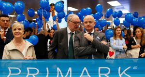 Arthur Ryan, centre, talks with Primark chief executive  Paul Marchant in  2014. 'I was fortunate enough to work closely with him and experience first-hand his sharp mind and innovative thinking,' Mr Marchant said. Photograph: Javier Barbancho/Reuters