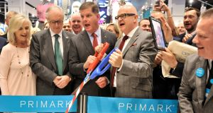 Arthur Ryan, second from left,  and Alma Carroll at the opening of Primark's store in Boston in 2015, alongside Mayor Martin Walsh and  Primark chief executive Paul Marchant. Photograph: Josh Reynolds