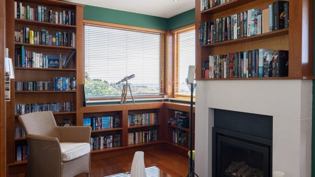 A very cosy dual aspect book-lined study with its own fireplace.