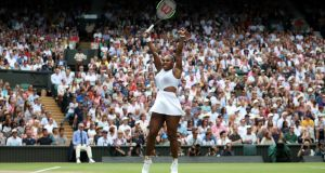 Serena Williams of the US celebrates winning her quarter final match against Alison Riske at Wimbledon. Photo: Hannah McKay/Reuters