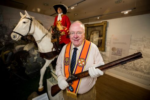 TWELFH CELEBRATIONS: Orange Order grand secretary Mervyn Gibson beside a replica of a Jacobite Catholic solider, holding a dragoon carbine originally presented to the Battle of the Boyne Visitor Centre by the late Dr Ian Paisley, at the Museum of Orange Heritage, at Schomberg House, Belfast. Photograph: Liam McBurney