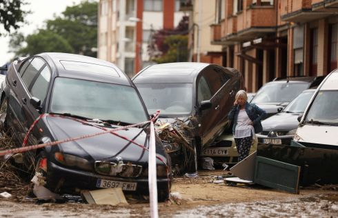 AFTER THE FLOODS: A woman surveys the damage after flash flooding caused by heavy rainfall in Tafalla, Spain. Photograph: Susanna Vera/Reuters
