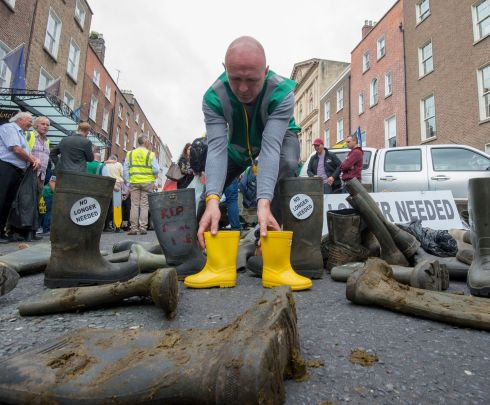 A pile of slogan-daubed wellies outside the Dail today, which were brought in numbers by farmers who held a protest outside D?il Eireann today regarding the Mercosur trade deal between the EU and South American countries.  Photograph: Dave Meehan for the Irish Times