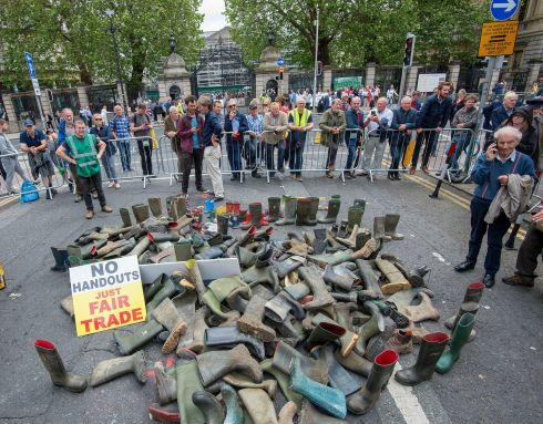 Piles of discarded wellies outside the Dail today as farmers held a protest outside Dail Eireann today regarding the Mercosur trade deal between the EU and South American countries.  Photograph: Dave Meehan for the Irish Times