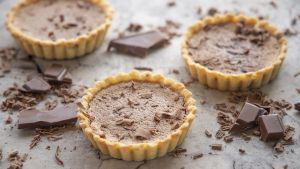 Chocolate custard tarts. Photograph: Harry Weir