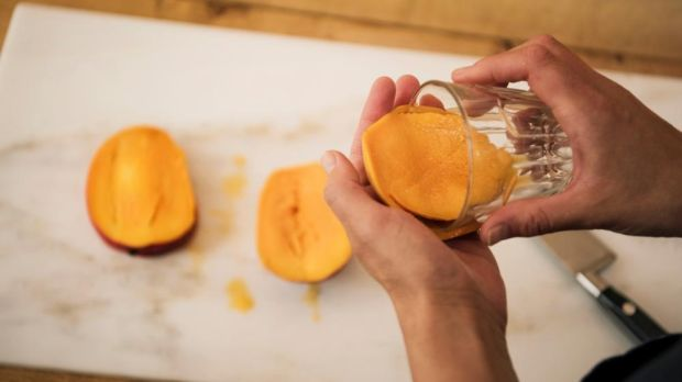 Use a glass to separate mango flesh from skin. Photograph: Linda Nylind/The Guardian