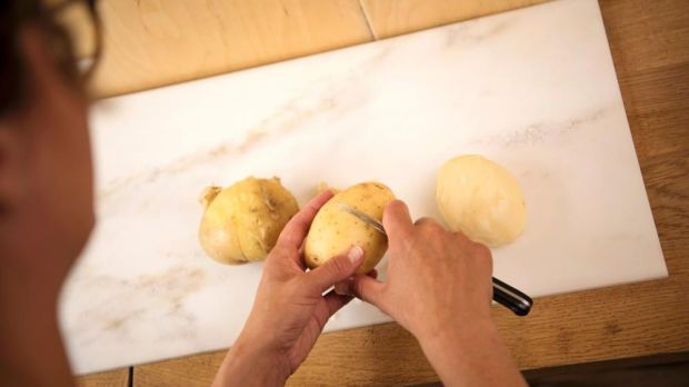 Score your spuds to help them out of their jackets. Photograph: Linda Nylind/The Guardian