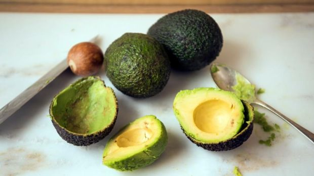 Run a dessert spoon between the flesh and skin of your avocado. Photograph: Linda Nylind/The Guardian