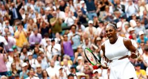 Serena Williams celebrates her victory over Alison Riske in their Wimbledon quarter-final. Photograph: Nic Bothma/EPA