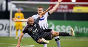 Dundalk's Sean Hoare tackles Roman Debelko of Riga FC. Photo: Morgan Treacy/Inpho