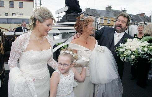 Brendan Grace, wife Eileen with their daughter Amanda as she arrives for her wedding at St. Flannan's church, Killaloe. Photograph: Fergal Shanahan