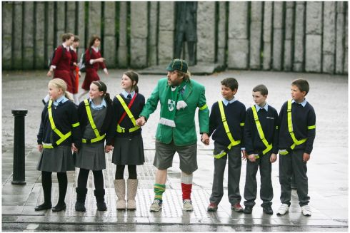 Brendan Grace as Bottler with children from Derrywash National School, Castlebar, Co Mayo, at the lauch of road safety campaign aimed at primary school children. Photograph: Bryan O'Brien/The Irish Times