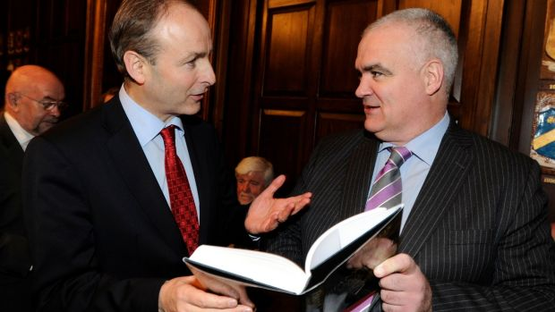Pictured in 2011 at the launch of his book, Fianna Fail: A Biography of the Party, is author Noel Whelan (right) with Fianna Fáil leader Micheál Martin. Photograph: The Irish Times