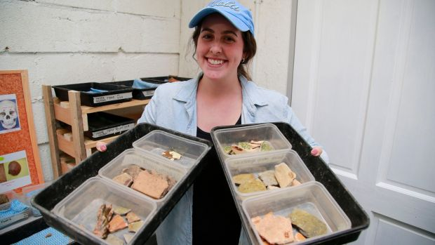 "Maddie Harris with ""finds"" from the archaeological dig at the Norman settlement in the National Heritage Park, Co Wexford. Photograph Nick Bradshaw"