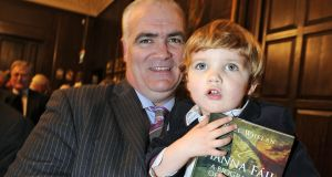 At the launch of his 2011 book, Fianna Fáil: A Biography of the Party.  Noel Whelan, with his son Séamus, then aged 2. Photograph: Dave Meehan