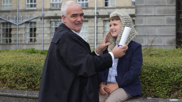 Noel Whelan with his son, Séamus (9) pictured following a ceremony in the Supreme Court last year after he was called to the inner bar. Photograph: Collins Courts