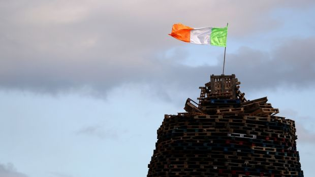 "A tricolour on top of a bonfire in the Sandy Row area of Belfast before ""Eleventh night"" on July 11th. Photograph: Brian Lawless/PA"