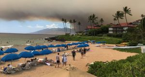 Smoke blankets the sky as a wildfire spreads in Maui, Hawaii. Photograph: Roger Norris/via Reuters