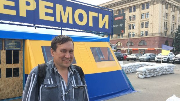 Activist Boris Redin beside a tent in the eastern Ukrainian city of Kharkiv, where volunteers collect money for the country's war effort. City mayor Hennadiy Kernes wants to remove the tent. Photograph: Daniel McLaughlin