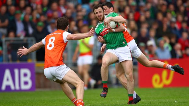 Armagh's Jarlath Og Burns and Rory Grugan battle against Darren Coen of Mayo. Photograph: James Crombie/Inpho