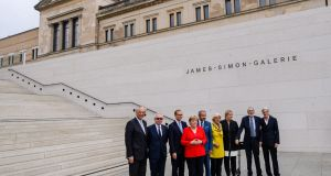 German chancellor Angela Merkel with others including British architect David Chipperfield at the opening of the James Simon Gallery building in Berlin. Photograph: Jens Schlueter
