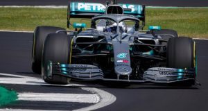 Finnish Formula One driver Valtteri Bottas of Mercedes  in action during the second practice session of the British Grand Prix at the Silverstone Circuit. Photograph: Valdrin Xhemaj/EPA