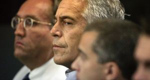 Jeffrey Epstein, centre, His expected to appear before a federal magistrate Monday, more than a decade after he gained notoriety for lurid accusations that he paid dozens of girls for sexual massages in Florida. File Photograph: Uma Sanghvi/Palm Beach Post via AP