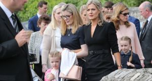 Maria Bailey TD (black dress) arrives at Church of the Assumption in Dalkey for the funeral of her father John who died on Tuesday. Photograph: Crispin Rodwell