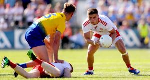 Michael McKernan gathers for Tyrone. Photo: Oisin Keniry/Inpho