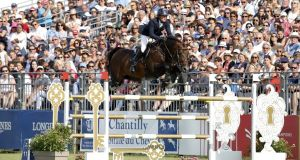 Darragh Kenny and Balou du Reventon on their way to victory in the Chantilly Longines Global Champions Tour Grand Prix. Photograph: Stefano Grasso/LGCT