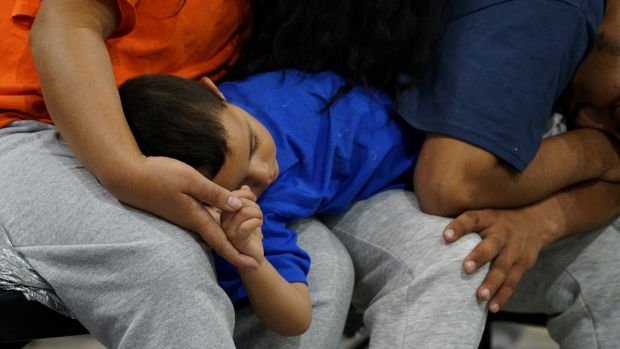 Asylum-seekers wait at the intake room at the Donna facility in Texas on July 12th, 2019. Photograph: Veronica G. Cardenas/Reuters