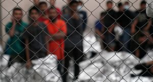 Single-adult male detainees stand inside a holding area inside the Border Patrol station in McAllen, Texas on July12th. Photograph: Veronica G. Cardenas/Reuters