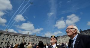 FLY PAST: Herve Olivieri, Member of ONE and Jaques Mention, Veterans of the Algerian and Tunisian War watch as the Air Corp perform a fly over during  the annual National Day of Commemoration Ceremony, to honour all those Irishmen and Irishwomen who died in past wars or on service with the United Nations, held in The National Museum of Ireland, Collins Barracks,  as well as at six locations across Ireland. Photograph: Alan Betson/The Irish Times